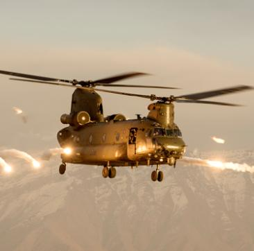 A Royal Air Force Chinook helicopter firing flares over Afghanistan.    Synonymous with operations in Afghanistan over the last thirteen years, the Chinook Force flew over 41,000 hours, extracted 13,000 casualties and its crews have been awarded numerous gallantry awards, including twenty three distinguished flying crosses for bravery in the air.